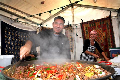 Mustafa Arslan  stirring a huge pot of  traditional Turkish food at last year's York Festival of Food & Drink