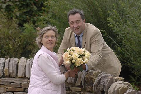 Caroline Smith receives her first bunch of roses named Rosa Geoffrey Smith in memory of her father from Ian Roger, managing director of the Pickering-based nursery RV Roger Ltd