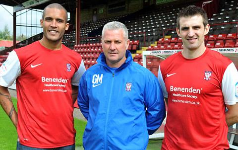 Clarke Carlisle pictured left with boss Gary Mills and striker Scott Dobie