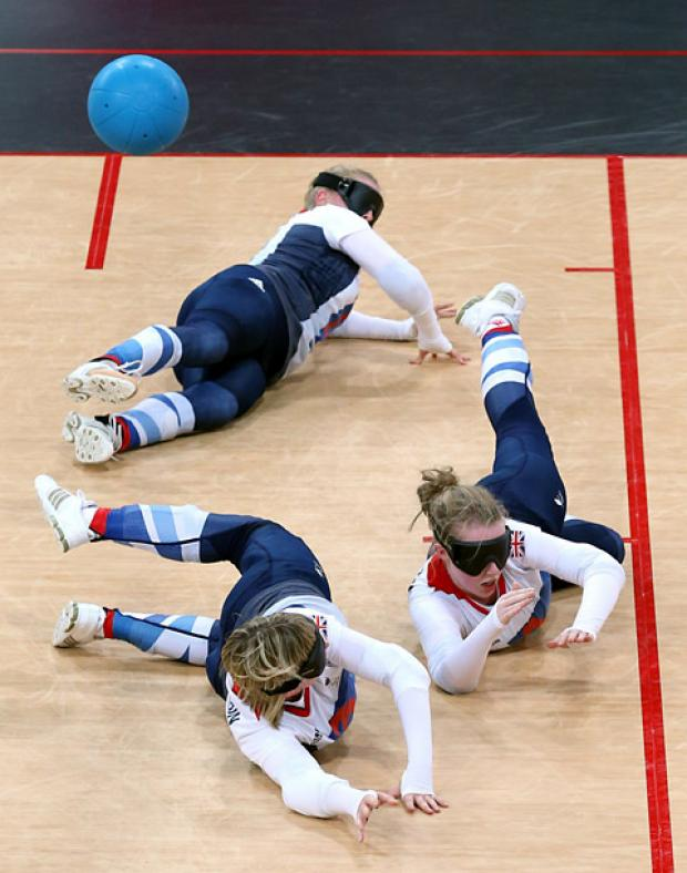 Great Britain goalball players Anna Sharkey, top, Georgina Bullen, right, and Jessica Luke, bottom, in action against China at the 2012 Paralympics