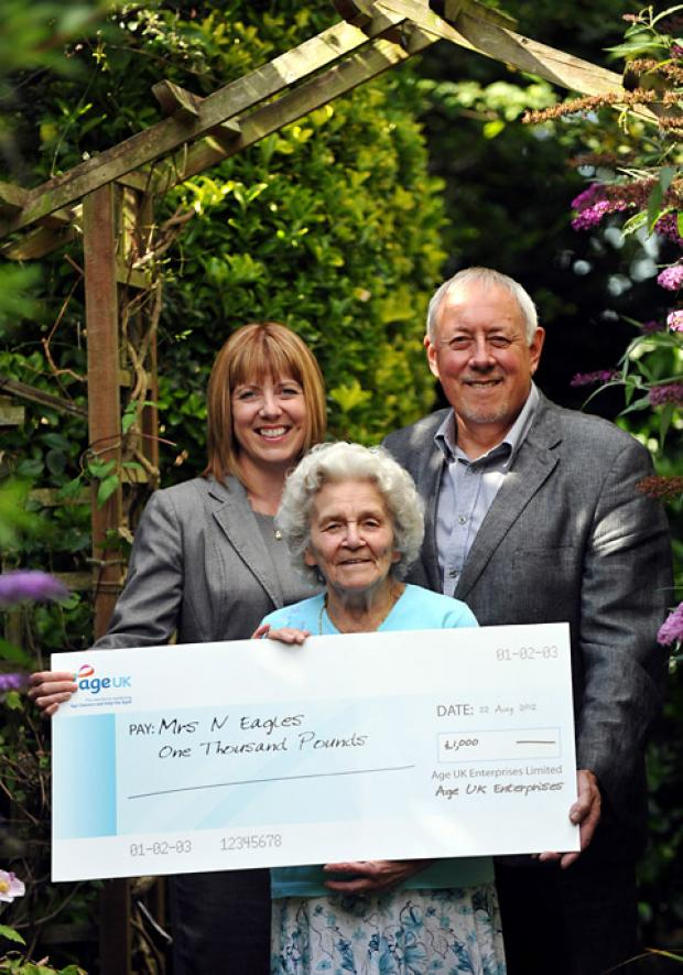 Nancy Eagles, centre, receives a cheque for £1000 from Yorkshire regional area manager, Elizabeth Hillary and Terry Cogan, trading manager Age UK York
