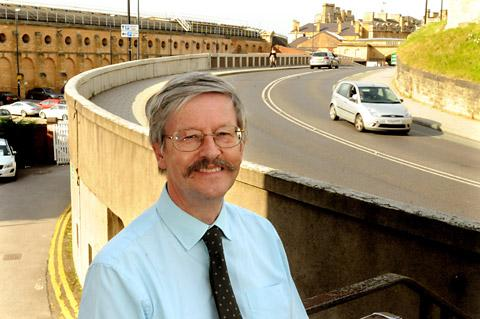 Coun Dave Merrett at Queen's Street bridge which would be demolished to create an interchange below
