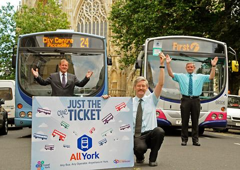 Coun Dave Merrett, City of York Council's transport head, with the new ticket and Keith Sykes, left,  operations manager for Transdev, and Peter McCarthy from First York