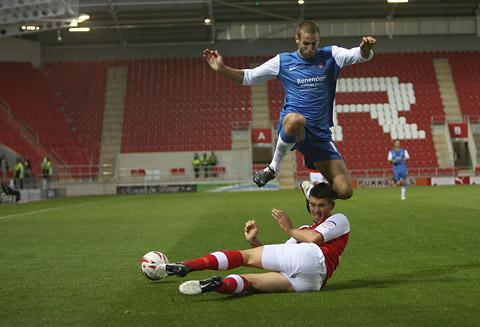York City's Matty Blair straddles a  sliding tackle. Picture: Gordon Clayton