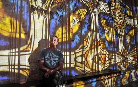 Andy McKeown is illuminated by a kaleidoscope of colour at York Minster