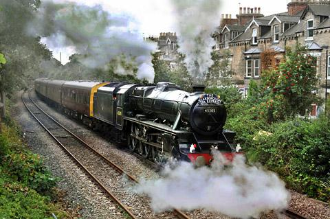 The Scarborough Spa Express (a Stanier black five class locomotive) takes on water at Grosvenor Terrace Bootham before making its way to the seaside town