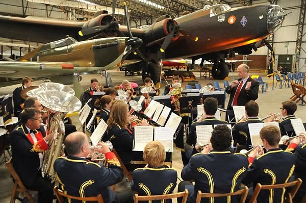 York Railway Institute Band play during a  previous Allied Air Forces Day service  at the Yorkshire Air Museum, Elvington