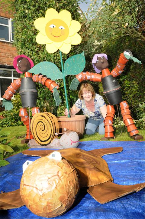 Linda Stubbins prepares for the Elvington Scarecrow Festival with her creation, The Flower Pot Men