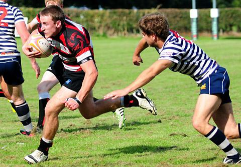 Malton & Norton scrum-half Dan Cattle breaks away for a  try against Pocklington