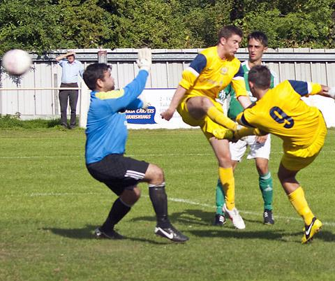 Callum Ward scores Tadcaster's second against Holker Old Boys. Pictures: Ian Parker