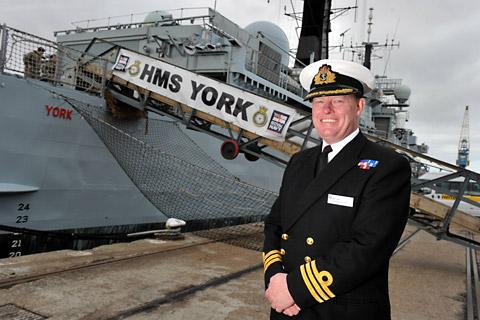 Commander Rex Cox by HMS York at King George Dock, Hull. Picture: Peter Harbour