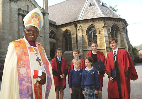 The Archbishop of York, Dr John Sentamu, with pupils of St Peter's School where he rededicated the chapel to mark the 150th anniversary of the York School.