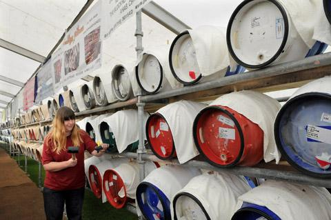York Beer Festival organiser Melissa Reed hammers a tap into a barrel inside the festival marquee on Knavesmire