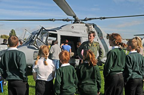 Flight observer Ed Targett chats to pupils at Applefields School about the helicopter