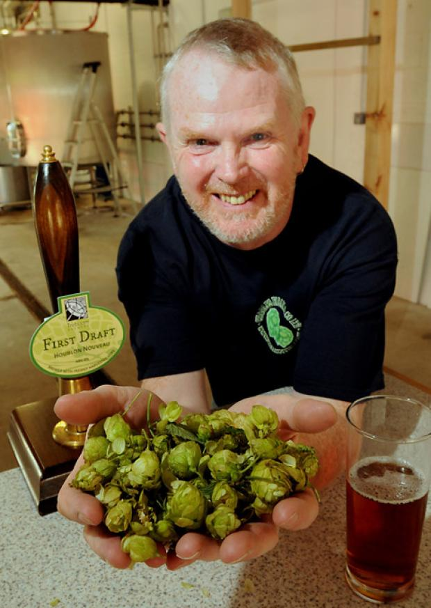John Lewis, of the Treboom Brewery at Shipton-by-Beningborough, with the freshly harvested green hops for the First Draft Pale Ale