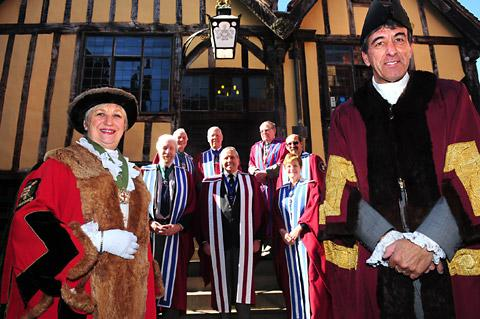 Hazel Hague, Master of the Freemen of the City of York, alongside Alan Fallows, President of Freemen of England and Wales, and members of the group's executive at the Merchant Adventurers' Hall