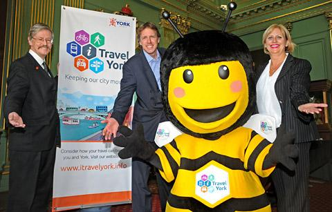 At the i-Travel York launch are, from left, Coun Dave Merrett, Graham Titchener, i-Travel York programme manager and Susie Cawood, head of York and North Yorkshire Chamber of Commerce, with the project's bee mascot, which will be named in a competition