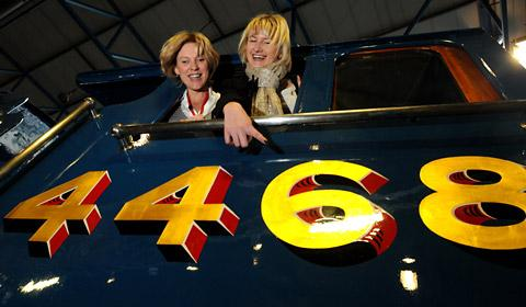 Kate Maughan-Brown, left, and Emma Rodgers of the National Railway Museum, admire the locomotive Mallard which has returned to be on display in the Great Hall
