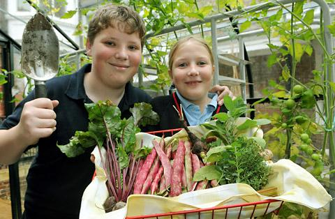 Two of Bootham School's gardeners, Oliver McGregor, 13, and Freya Leaf, nine, with some of the                  school-grown produce that they are taking to the York Food & Drink Festival