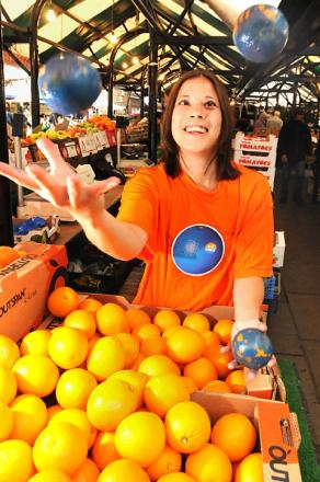 Natalie Brimicombe juggles with blue oranges in Newgate Market, York, to promote the production Blue/Orange at the Grand Opera House