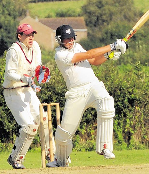 Yorkshire Academy star batsman Jack Leaning hits out at Sheriff Hutton Bridge spinner Joe Dale in the Phil Fisher memorial match