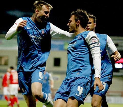 Defender Chris Smith, right, celebrates with Dan Parslow after getting on the scoresheet himself in this season's draw at Morecambe