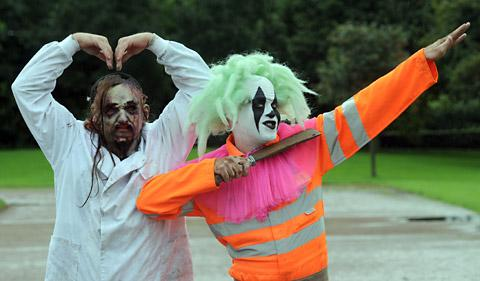 York Maze zombies celebrate Olympic style on the running track at the University of York