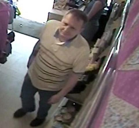 Man wanted over cash scams at charity shops