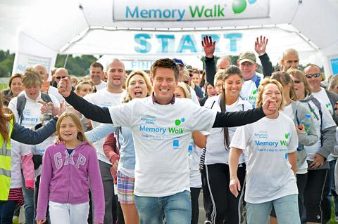 Richard McCourt, of Dick and Dom fame, starts the Memory Walk on York's Knavesmire