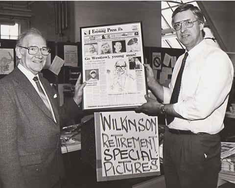 Former deputy editor, Donald Wilkinson, left, receiving a framed copy of a special Evening Press edition from Richard Wooldridge, the then editor, in April, 1988.