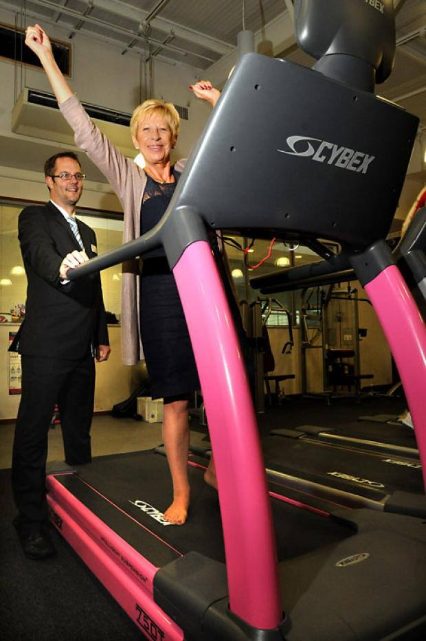 Janice Wilford, of York Against Cancer, stands on the new pink treadmill as Paul Bickle, manager of Energise looks on