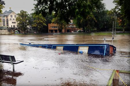A barge sinks in the swollen River Ouse in York  following heavy rain in the region.