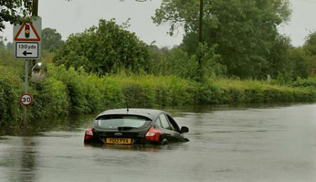 A car stuck in floodwater as the River Nidd broke its banks at Cattal