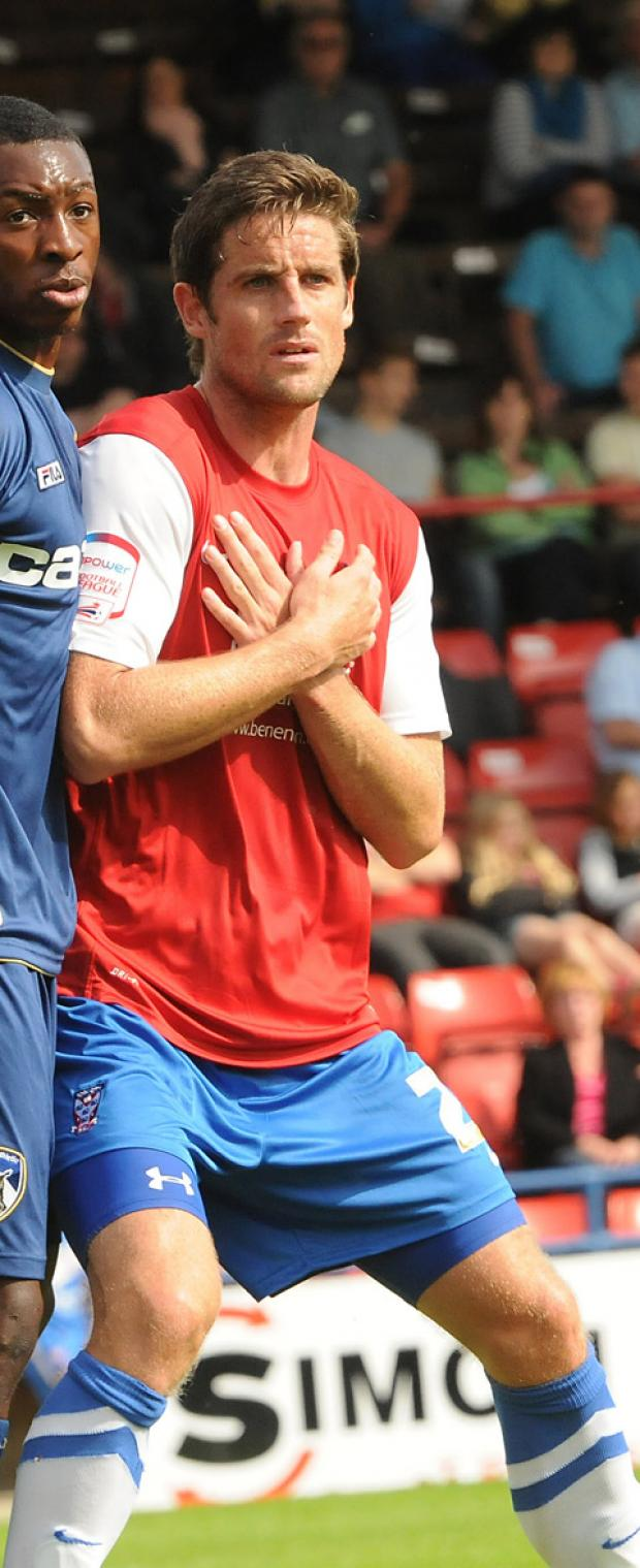 York Press: York City defender Chris Doig, above right, needs an operation on his injured ankle