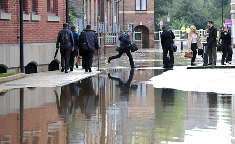 Workers from East Coast House  evacuate their offices as flood water rises rapidly in Skeldergate. Pic John Giles.