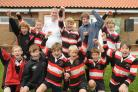 England Rugby Union coach Stuart Lancaster with some of the Malton & Norton Under 12s team