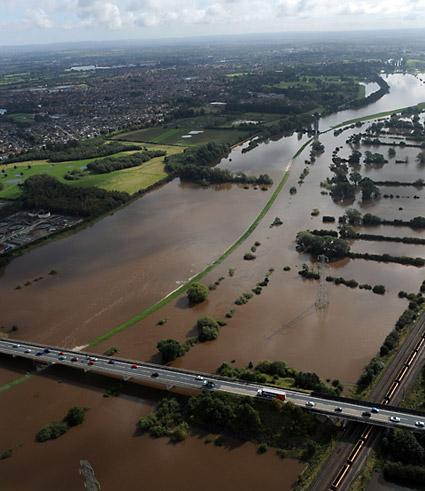 Cars pass over flood water near York's outer ring-road near Poppleton Park