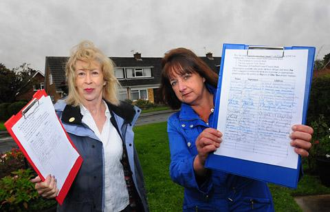Linda Maggs and Lita Black with their petition  opposing the removal of rubbish bins in Dunnington