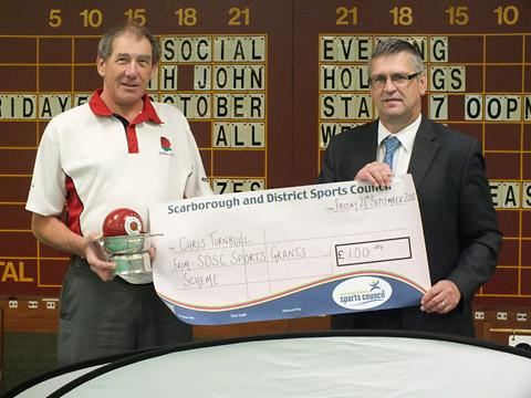 Chris Turnbull receives a grant from Scarborough District & Sports Council to help in his World Blind Bowls Championships glory bid