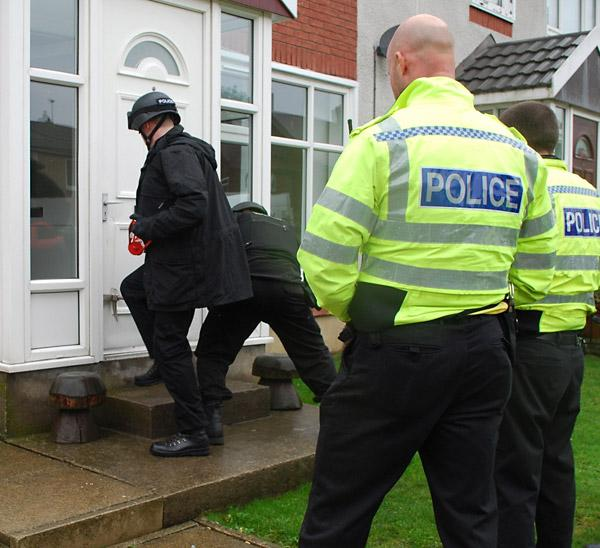 Police officers gain entry to the property in Harrogate