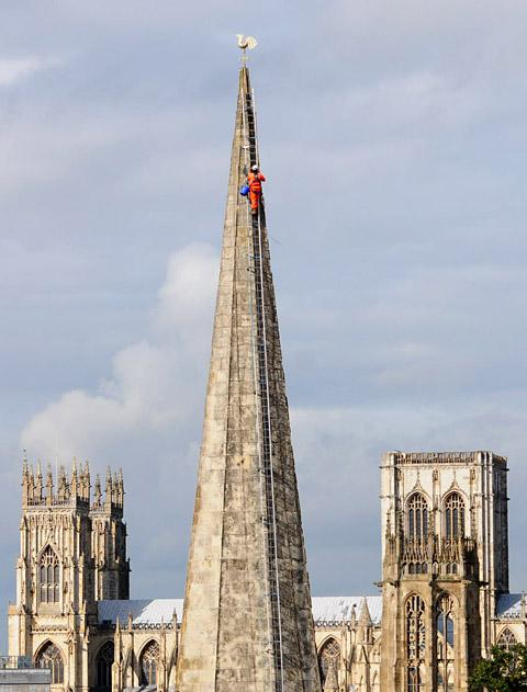 A steeplejack works on St Mary's Church in York