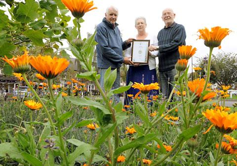 Haxby In Bloom organisers, from left, town council vice-chairman Alan Leak, St Mary's Church churchwarden Pam Thorpe and Memorial Hall treasurer Chris Moss, with the Yorkshire in Bloom Silver award