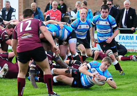 Malton and Norton scrum- half Dan Cattle dives to score