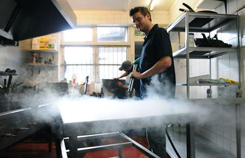 The kitchen at Ning restaurant, in Tower Street, is steam-cleaned in the clean-up operation after the flooding.