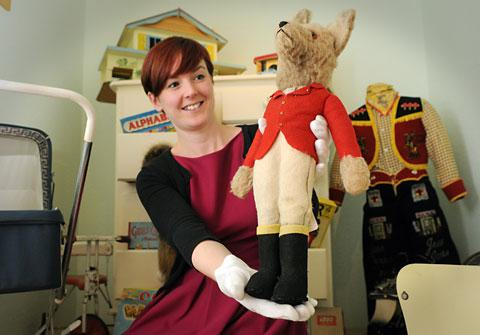 Katie Brown, the assistant curator of history at the Castle Museum, with a cuddly fox in the toy exhibition