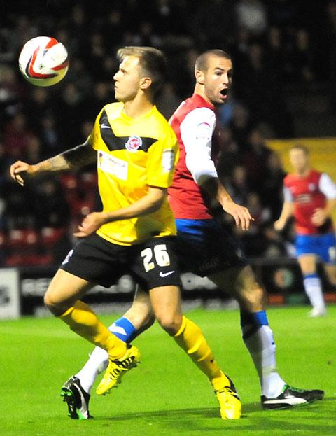York City's Matty Blair, right, is wrong-footed by a Fleetwood Town foe
