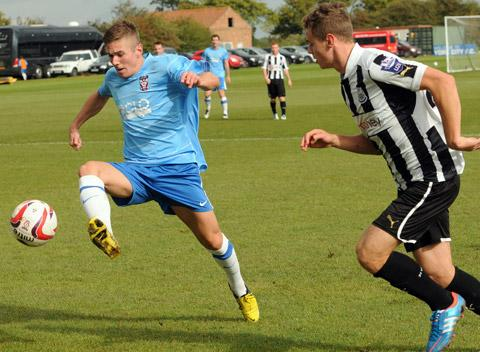 Daniel Kearns, left, in action against Newcastle United at York City's training ground