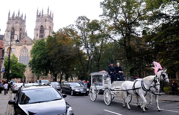 The hearse carrying Lydia Bishop leaves York Minster after the funeral service