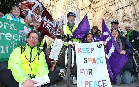 The chairman of CND, Professor Dave Webb, centre, with members Yorkshire CND call at York Minster on their three-day 100-mile bike ride from Whitby to Menwith Hill, Harrogate. They were greeted by  members of York Green Party and York Quakers