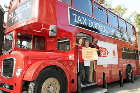 On board the tax justice bus, outside York Minster, are, from left, Claire Whitmore of Christian Aid, Jackie Worthington of Church Action on Poverty and Dr Dereje Alemayehu, Christian Aid's East Africa country manage
